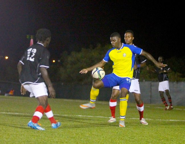 Rendezvous striker Shandel Samuel (with ball) had a good night scoring two goals. (Pictures by Morissa Lindsay)
