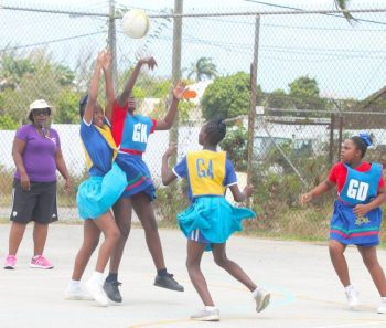 St Stephen's Primary goal-keeper (center) blocks a pass from St Joseph Primary goal-shooter Keandra Howard to goal-attack Brieanna Boyce.