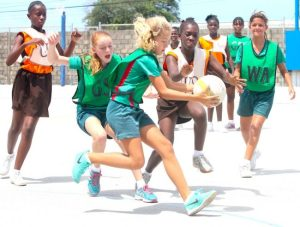 St Winifred's goal-attack Emma Hodgkinson takes a good catch away from Kiokya Leacock of Lawrence T Gay Primary.