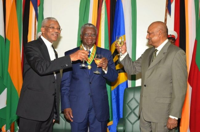 Guyana's President David Granger, Prime Minister Freundel Stuart and Chancellor of Guyana's Judiciary Justice Carl Singh toasting to the friendly relations between Guyana and Barbados.