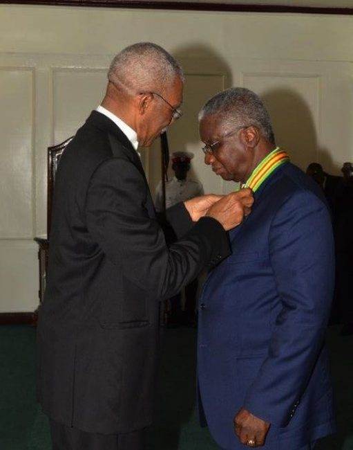 Guyana's President David Granger conferring Prime Minister Freundel Stuart with the National Award, the Order of Roraima.