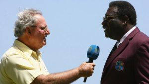 Tony Cozier (left) and Clive Lloyd.