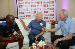 Tony Cozier speaking to Sir Vivian Richards and Sir Richard Branson.