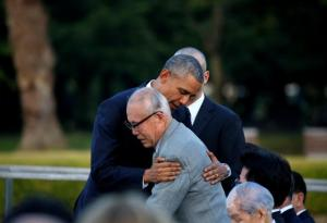 America's President Barack Obama (left) hugs an atomic bomb survivor Shigeaki Mori as he visits Hiroshima Peace Memorial Park in Hiroshima, Japan, on Friday.
