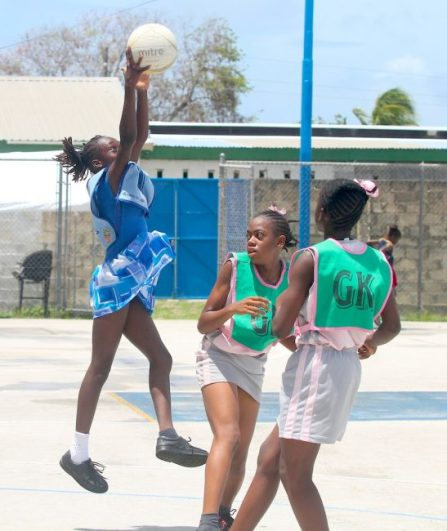 Belmont Primary goal-attack Tia Spellen showed good reach when she jumped and took possession away from St Giles' goal-defence Tianna Applewaithe (center) and goal-keeper Michaela Harper.