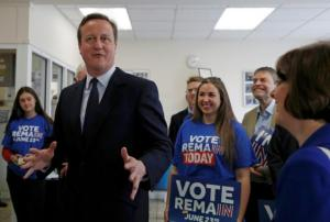 Britain's Prime Minister David Cameron gestures while speaking with campaign volunteers for 'Stronger In' during a visit to Panorama Antennas, a small family business in Wandsworth, south London.