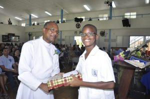 Elim Arthur receiving the Male Award for Music.
