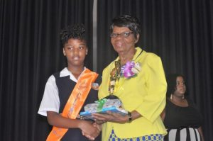 Emonie Toppin receiving the  prize for Top Student in the Barbados Secondary School Entrance Examination.