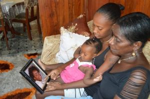 Antoinette Edward-Ward's mother Marion (right), sister Keisha and niece Keshana looking at a picture of their loved one.