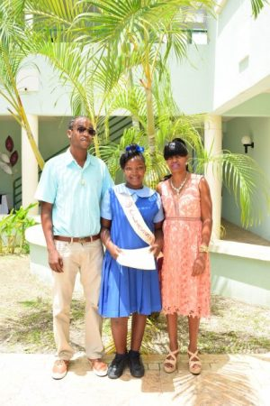 Most Outstanding Student and valedictorian Yassara Best with parents Stewart Best and Dacia Yarde.