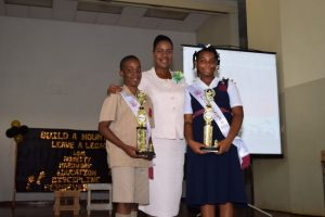 Top Girl Abigail Newton and Top Boy Jeremy Springer with principal Pamela Small-Williams.