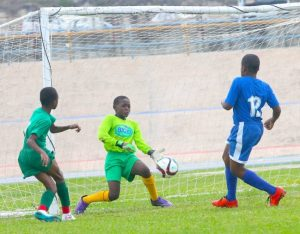 Dominic Downes scored St Cyprian's second goal past Bay Primary goalkeeper Michael Browne.