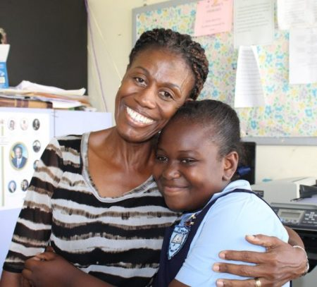 Class teacher Phyllis Griffin embraces St Mark's student Shania Lynch.