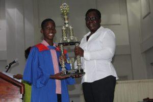 Khalil Vanderpool-Nurse receiving the Ladine Clarke Memorial Award For Highest Score in the Barbados Secondary Schools Entrance Examination.