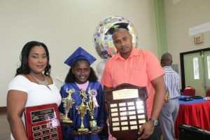Top girl Taylia Bretney with mum and dad Tanya and Alvin Bretney.