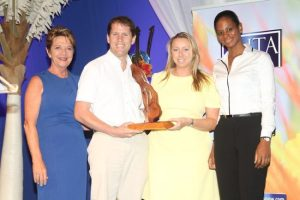 CEO of the BHTA, Sue Springer (at left) presented the St Nicholas Abbey staff with the Attractions Award.