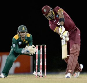 Kieron Pollard's positive batting led West Indies to a four-wicket win. The wicketkeeper is Quinton de Kock.