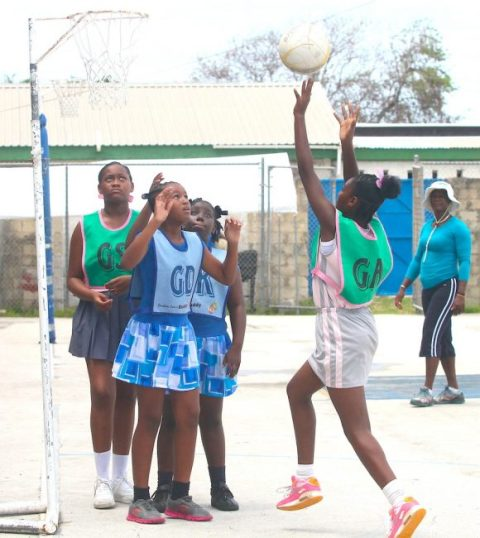 St Giles Primary's goal-attack was in great shooting form and netted another goal under the watchful eyes of National Sports Council coach Monette Wharton. (Pictures by Morissa Lindsay).