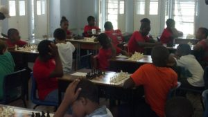 Students battling for primary school chess glory.