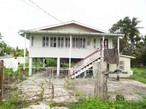 The two-storey house located at Crane Old Road in which the body of the murdered security guard was found yesterday.