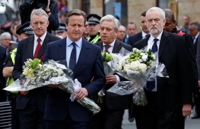 Prime Minister David Cameron leads Labour Party leader Jeremy Corbyn (R), John Bercow, Speaker of the House of Commons (2nd R) and Labour MP Hilary Benn (L) as they pay tribute near the scene where Labour Member of Parliament Jo Cox was killed in Birstall near Leeds. REUTERS/Craig Brough