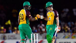 Amazon Warriors' Dwayne Smith (l) and Nic Maddinson (r) having a laugh at Tridents' expense.
