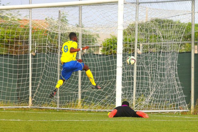 Barbados striker Avery Chandler scored the first of Barbados' two goals as he buried this ball past St Lucia custodian Atley Clovis.