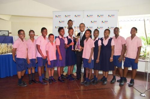 Charles F Broome team (from left) Gabriel Murray, Jerem Gittens, Joshua Harris, Jaydn Gill, Vanessa Greenidge, Parry Marshall (head of the PTA), Azaria Johnson (captain), Dwight Lashley (representitive of Massy United), Yeshua Hill, Gaybrianna Moore, Jalesa Best, Ashebe Boyce and Dominic Small.