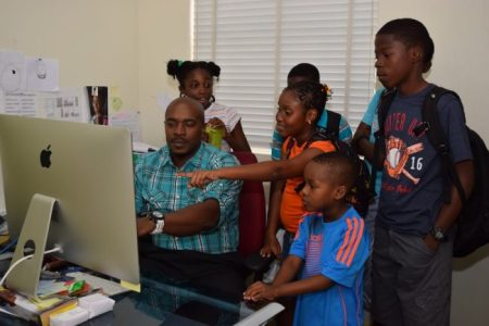 Creative and Technical Manager Henry Richards talking to students about the Barbados TODAY E-Paper.
