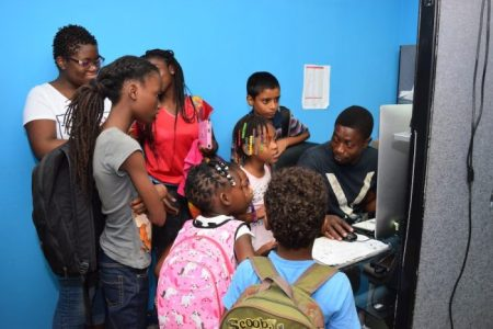 Video Editor/Director Kwame McDowall teaching campers about video and picture editing.