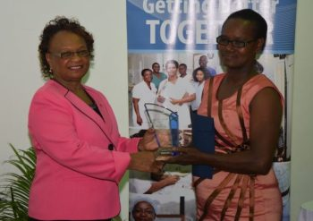 General worker Ernesta Thomas (left) receiving the Service Excellence Award.