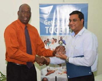 Chief Executive Officer  Dr. Dexter James presenting Dr. Shazad Mohamed with the STAR Award.