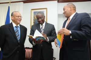 "Dr Jean Holder (left) discussing his book ""Caribbean Tourism"", with Prime Minister Freundel Stuart (centre) and Minister of Tourism sRichard Sealy back in March 2014."