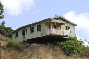 As a result of extensive land slippage this house at White Hill, St Andrew is on the verge of falling over the edge.