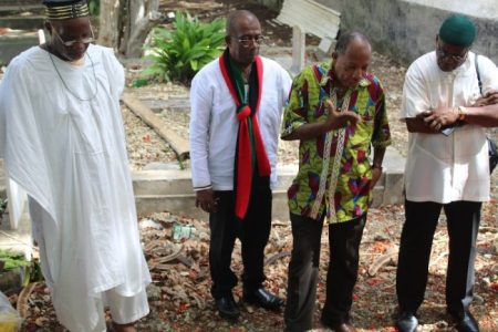From left, Pan Africanists Babatifase Somorin, Trevor Prescod, David Denny and Imtiaz Ali at Israel Lovell's graveside.