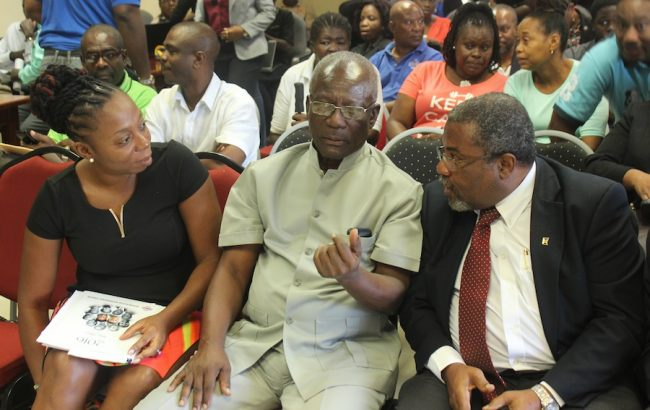 From left, BWU General Secretary Toni Moore; her immediate predecessor Sir Roy Trotman and John Williams of the Barbados Employers' Confederation discussing the verdict. In the background some of the severed workers.