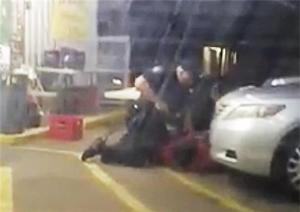 In this photo taken from video, Alton Sterling is held by two Baton Rouge police officers, with one holding a hand gun, outside a convenience store in Baton Rouge, Louisiana, on Tuesday.