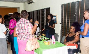Khadija speaking to patrons on Curls Nite Out Summer Edition.