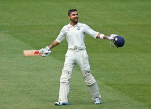 India's captain Virat Kohli celebrates his 12th century in Test cricket today in Antigua.