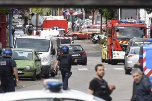 Police and rescue workers stand at the scene after two assailants had taken five people hostage in the church at Saint-Etienne-du -Rouvray near Rouen in Normandy, France.