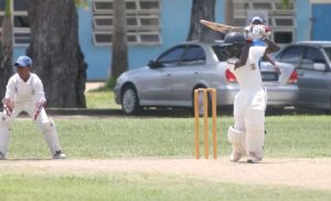 St Leonard's Boys' captain Rivaldo Clarke opens the face of the bat and drives for four.