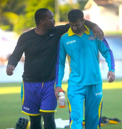 Tridents manager Jason Harper (left) sharing a light moment with Tridents' leading CPL run-scorer Shoaib MaliK. (Pictures by Morissa Lindsay)