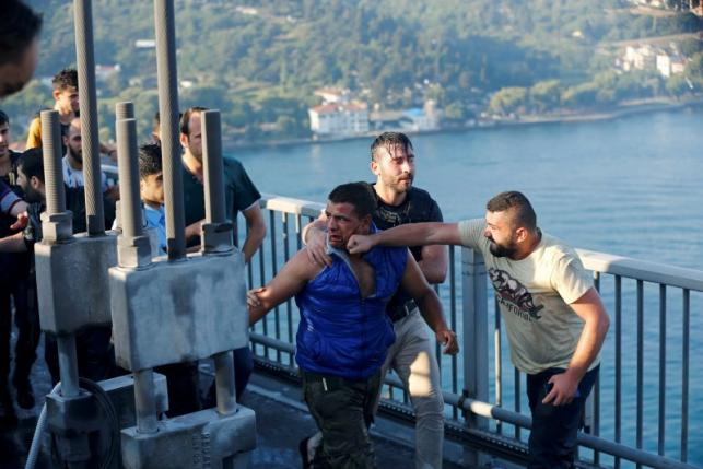 A civilian beats a soldier after troops involved in the coup surrendered on the Bosphorus Bridge in Istanbul, Turkey July 16, 2016. REUTERS/Murad Sezer