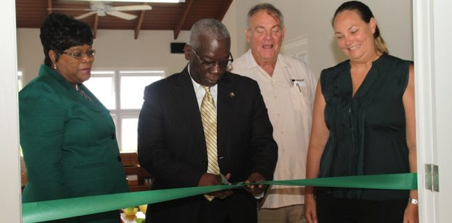 Minister of Education Ronald Jones (second from left) cutting the ribbon at the official opening of St Luke's Academy at White Hall St Peter. Looking on are Chief Education Officer Karen Best (left), founder of the school and businessman Bjorn Bjerkham (second from right) and his daughter who is principal of the school Angelique Edwards.