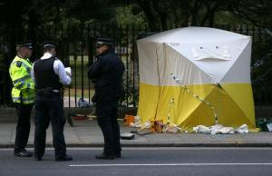 Police officers stand near a forensics tent after a knife attack in Russell Square in London, Britain, on Thursday.
