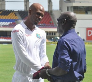 Sir Vivian Richards (right) giving Roston Chase some advice.