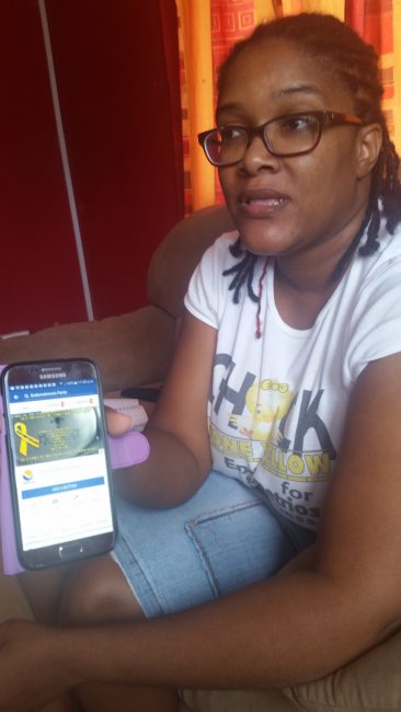 Dawn Williams showing the Facebook page she started to spread the word about endometriosis.