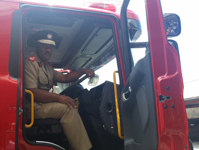 Newly appointed Chief Fire Officer of the Barbados Fire Service Errol Maynard sitting in the driver's seat of Barbados' first multimedia fire truck.