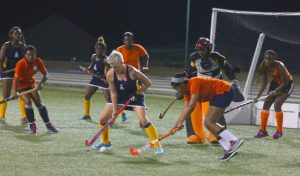 Cherise Mapp (tackling) and the rest of the Avengers women (wearing orange) had a tough task keeping Cher King of Combermere School Old Scholars quiet.
