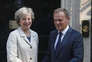 Britain's Prime Minister Theresa May (left) greets European Council President Donald Tusk in Downing Street  in London, Britain, on Thursday.